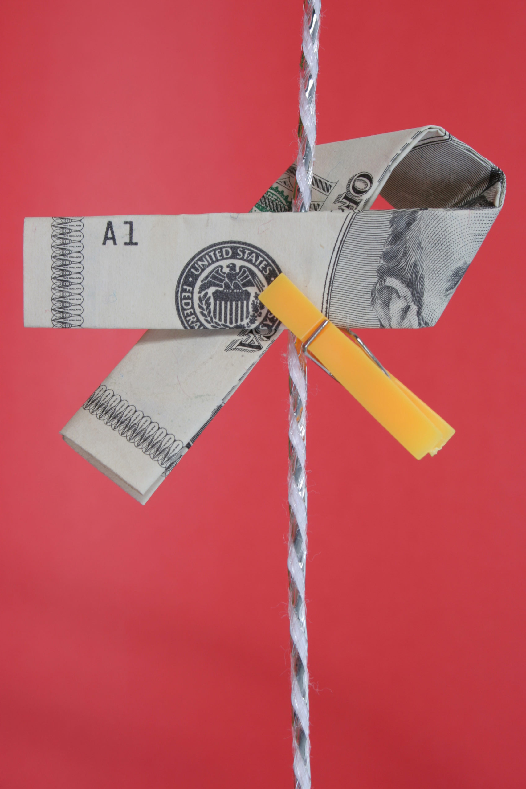 Organizations that help cancer patients financially ribbon & clothespin on string